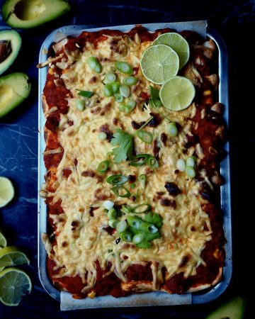 The enchiladas with roasted vegetables seen from above with lime, avocado, coriander, spring onion
