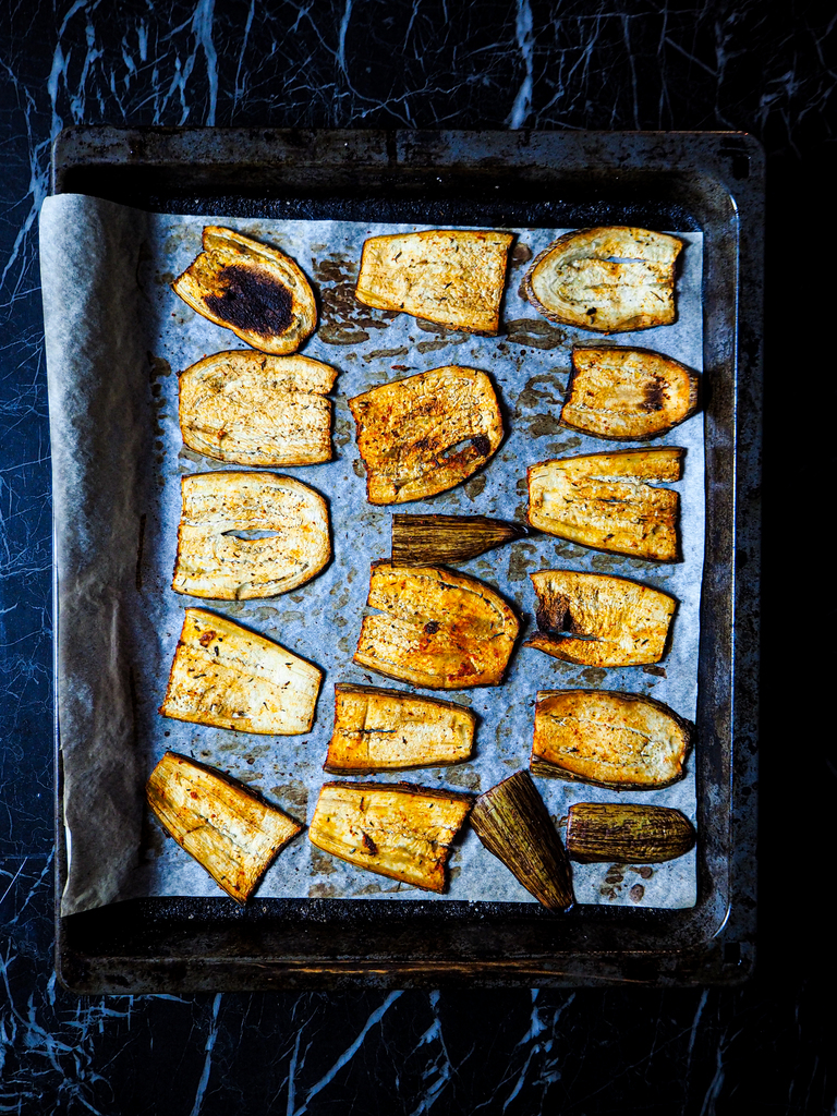 oven tray with baked aubergine slices seen from above